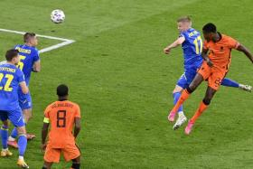 Denzel Dumfries heading in Netherlands' winner.