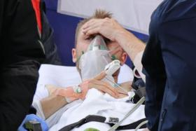 Christian Eriksen being carried off the pitch after being resuscitated following cardiac arrest in the match against Finland.