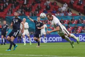 England captain Harry Kane attempting a header against Scotland.
