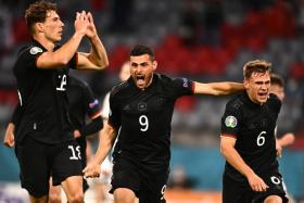 Germany's Leon Goretzka (left) celebrates with teammates Kevin Volland (centre) and Joshua Kimmich after making it 2-2.