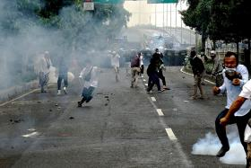 Clashes ensue as Indonesia jails cleric over Covid-19 lies