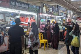 Geylang market still busy, but it is a little quiet elsewhere