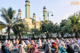 These photos show Indonesians praying outside a mosque to mark Eid al-Adha in Bekasi on Java last year versus this year, when restrictions are being tightened.