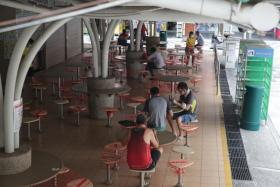 TraceTogether check-in a must at all wet markets, hawker centres
