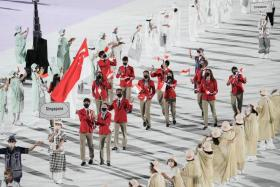 Team Singapore's flag bearers Loh Kean Yew and Yu Mengyu leading out the Republic's contingent at the Tokyo 2020 opening ceremony.