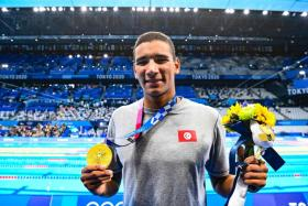 Tunisian teenager Ahmed Hafnaoui raced a sizzling last 50m to beat Australia's Jack McLoughlin and US swimmer Kieran Smith to the 400m freestyle gold.
