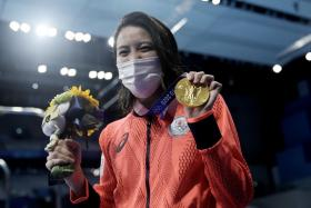 Japan's Yui Ohashi celebrates her gold-medal victory in the women's 400m individual medley.