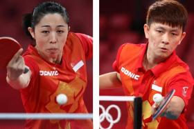 Singapore's Yu Mengyu (left) and Clarence Chew (right).