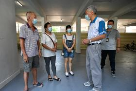 Singapore ramps up testing, urges seniors to get vaccinated