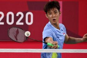 Singapore's Loh Kean Yew put up a good fight against Indonesia's Jonatan Christie.
