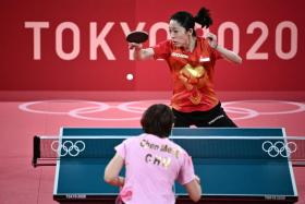 Yu Mengyu (in red) will be playing in the women's singles bronze medal play-off on Thursday after losing to China's Chen Meng.