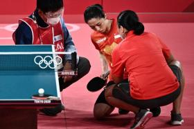 Singapore's Yu Mengyu receiving medical attention on her left thigh.