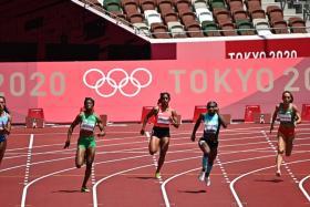 Singapore's Shanti Pereira on her way to setting a season's best in the Tokyo 2020 women's 200m heats.
