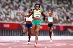 Thompson-Herah makes history by defending sprint double