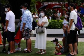 Japan warns of unprecedented Covid spread as cases hit new high