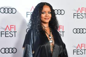 """In this file photo taken on November 14, 2019 Barbadian singer/actress/designer Rihanna arrives for the AFI Opening Night Gala premiere of """"Queen & Slim"""" at the TCL Chinese Theatre in Hollywood."""