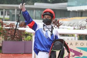 Jockey Zyrul Nor Azman celebrating his first double of the year with $32 chance Loving Babe and $96 outsider Hosayliao on Sunday. He had five rides.