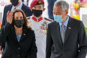 US Vice-President Kamala Harris is welcomed by Prime Minister Lee Hsien Loong at the Istana yesterday.