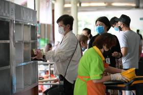 Most patrons at some hawker centres clear their own trays