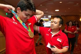 Ex-spokesman for Joseph Schooling charged with 21 counts of cheating