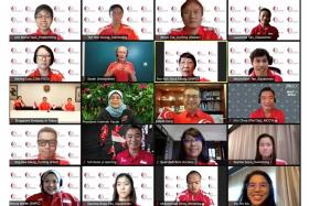 President Halimah Yacob (centre row, second from left) engaging Paralympians, politicians and officials during yesterday's virtual session.