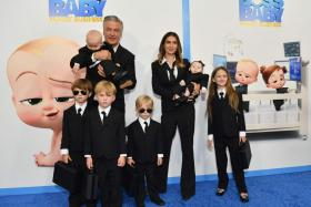 """US actor Alec Baldwin (L), wife Hilaria Baldwin (R) and their children attend DreamWorks Animation's """"The Boss Baby: Family Business"""" premiere at SVA Theatre on June 22, 2021 in New York City."""