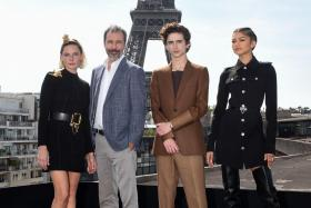 """(LtoR) Swedish actress Rebecca Ferguson, French-Canadian director Denis Villeneuve, US actor Timothee Chalamet and US actress Zendaya pose during a photocall session for the American epic science-fiction movie """"Dune"""" in Paris, on September 6 2021."""