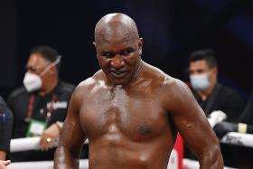 Holyfield, 58, humbled by 1st-round TKO