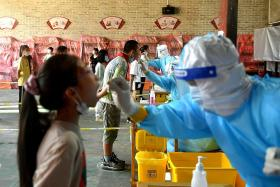 Chinese cities issue travel warnings after Fujian's Covid-19 outbreak