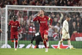 Liverpool skipper Jordan Henderson celebrates after scoring the winner.