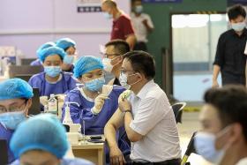 China fully vaccinates more than 1 billion as Fujian battles Covid-19
