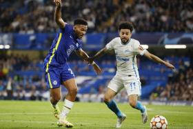 While Chelsea's Reece James (in blue) was playing in a Champions League game against Zenit Saint-Petersburg, burglars broke into his home and stole a safe containing his Champions League winners' medal.