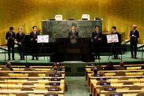 (L to R) Taehyung/V, Suga, Jin, RM, Jungkook, Jimin and J-Hope of South Korean boy band BTS speak at the SDG Moment event as part of the UN General Assembly 76th session General Debate in UN General Assembly Hall at the United Nations Headquarters, in New York, U.S., September 20, 2021.