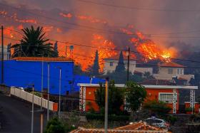 Lava swallows 100 homes as Canary Islands volcano erupts