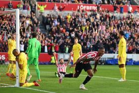 Brentford's Ethan Pinnock celebrates after scoring the opening goal in a 3-3 draw with Liverpool.