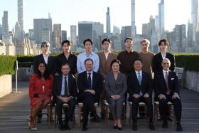 First lady of South Korea Kim Jung-sook (3-R, front row) and members of the music group BTS (second row) pose for a photo at the Metropolitan Museum of Art in New York, New York, USA, 20 September 2021.