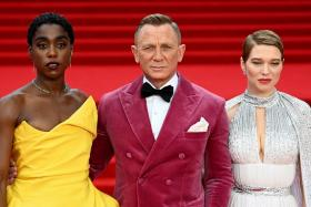 Actors/cast members (L-R), Lashana Lynch, Daniel Craig, and Lea Seydoux pose for photographers at the world premiere of the new James Bond film 'No Time To Die' at the Royal Albert Hall in London, Britain, 28 September 2021.