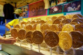 """A street vendor sells Dalgona candy from the Korean Netflix series """"Squid Game"""" at a Dalgona shop in Seoul, South Korea, October 1, 2021."""
