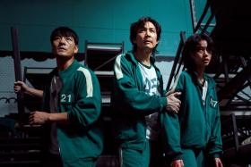 (L-r) Park Hae-soo, Lee Jung-jae and HoYeon Jung in Squid Game