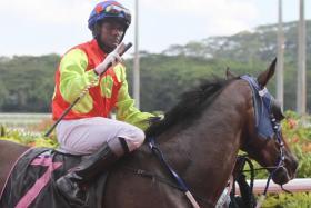 Jockey John Sundradas on Strong N Best.