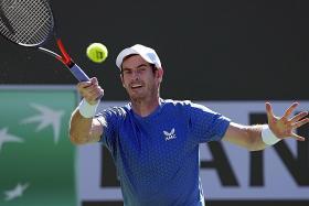 Andy Murray rallies to beat rising teen Carlos Alcaraz