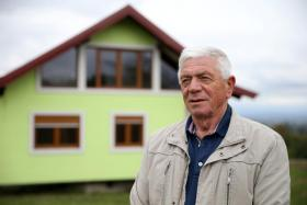 Mr Vojin Kusic in front of his rotating house in Srbac, Bosnia and Herzegovina.