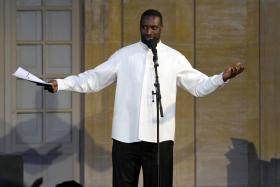 """In this file photo taken on July 10, 2021 French actor Omar Sy performs on stage during a reading of """"Frere d'ame"""" by David Diop, as part of the Avignon Theatre festival, in Avignon, southern France."""