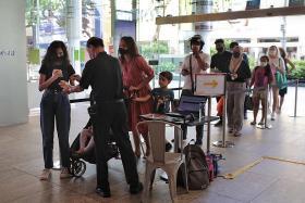 Queues form at malls as vaccination status checks begin