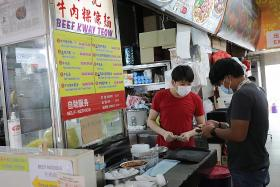 Confusion at hawker centres, coffee shops as stricter rules kick in