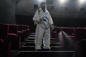 Cinemas, gyms in Manila to reopen in bid to boost jobs