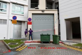 The man was found caught between the door and the discharge outlet of the waste compactor in the central rubbish chute of Block 623C in Punggol Central.