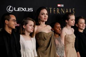 """Cast member Angelina Jolie poses with her children Maddox, Vivienne, Zahara, Shiloh and Knox at the premiere for the film """"Eternals"""" in Los Angeles, California, U.S. October 18, 2021."""