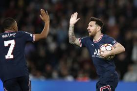 Lionel Messi celebrates with Kylian Mbappe after scoring Paris Saint-Germain's second goal.