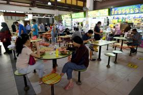 The NEA and SFA have been engaging operators of hawker centres and coffee shops and will continue to fine tune the system, said Finance Minister Lawrence Wong.